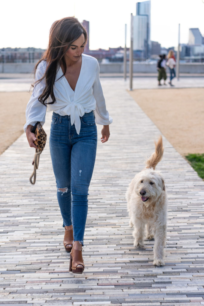 Model in Blue Jeans and white tie front shirt with our dog.