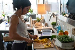 Athlete preparing a healthy snack.