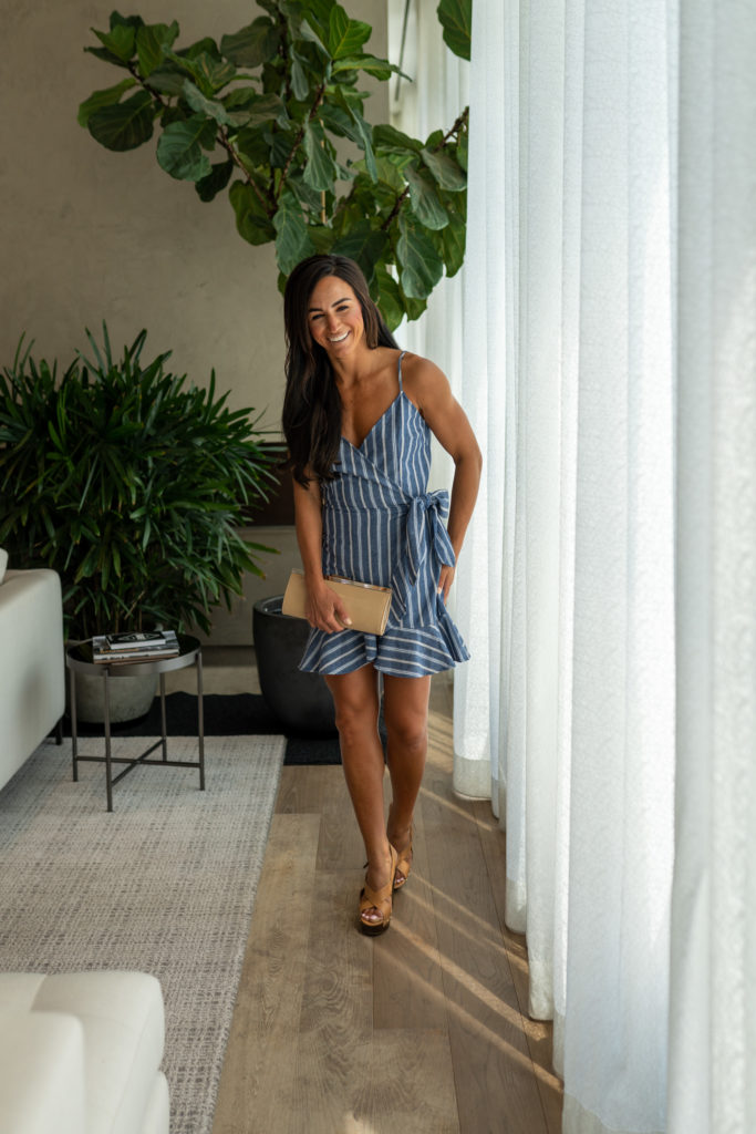 Model wearing blue dress with white stripes