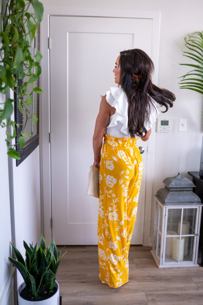 Model wearing yellow pants and white top.