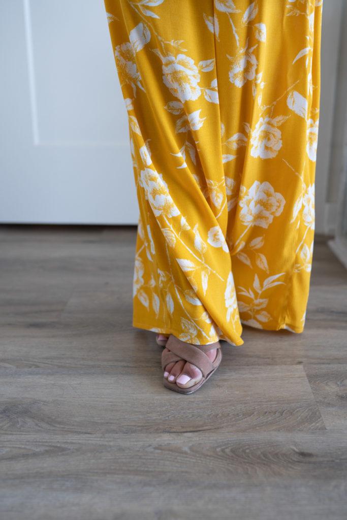 Model wearing yellow pants.