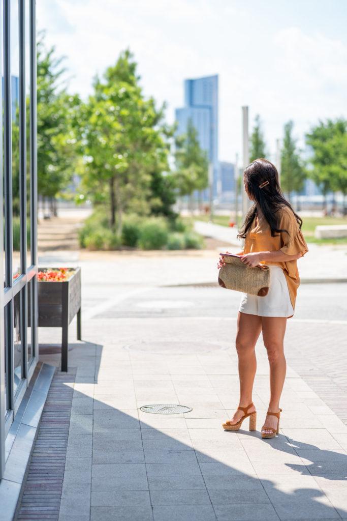 Model wearing white shorts in summer.