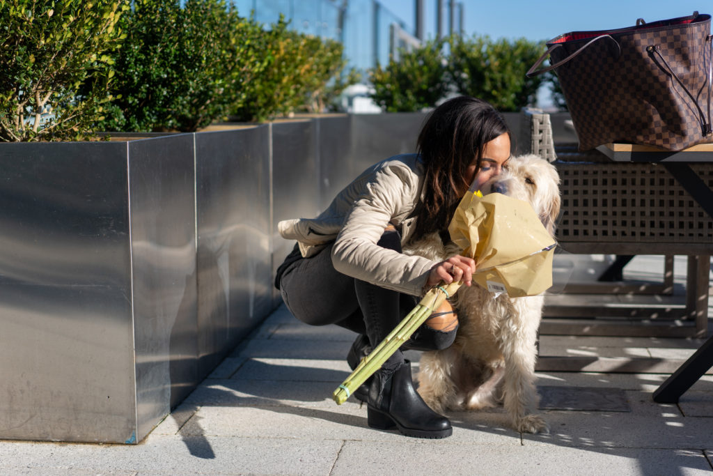 Model kissing her dog.