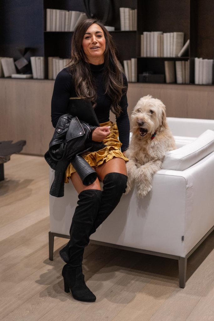 Model wearing black OTK Boots with dog.