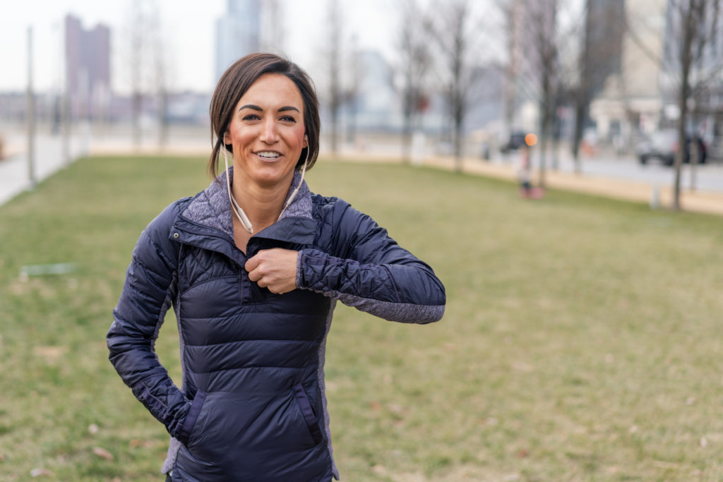 Model wearing cold weather running gear.