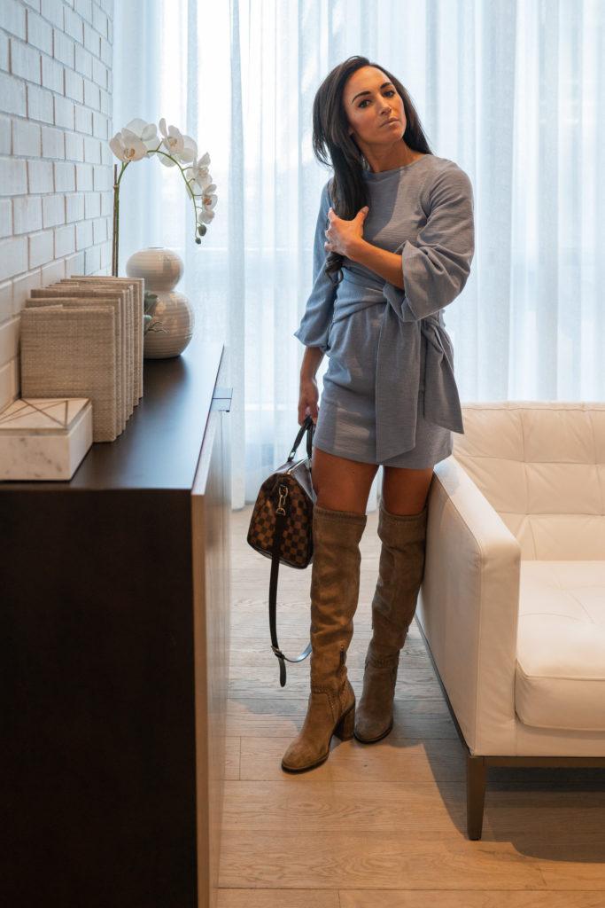 Model wearing blue tie front dress.