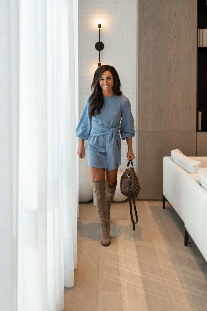 Model wearing blue amazon tie front dress.