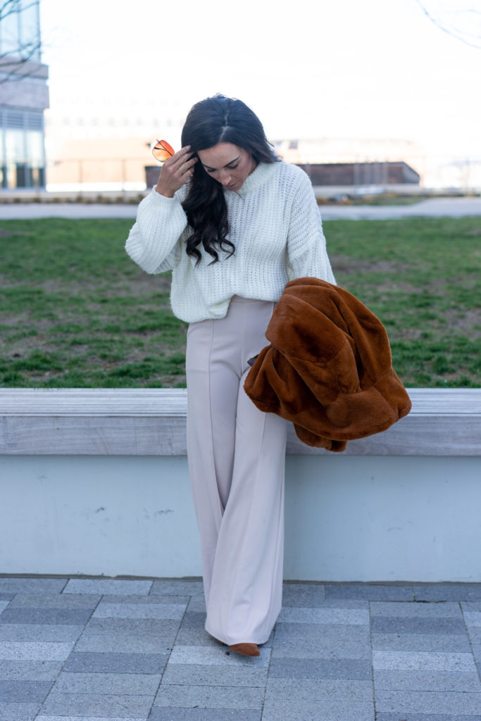 Model wearing wide legged pants and sweater.