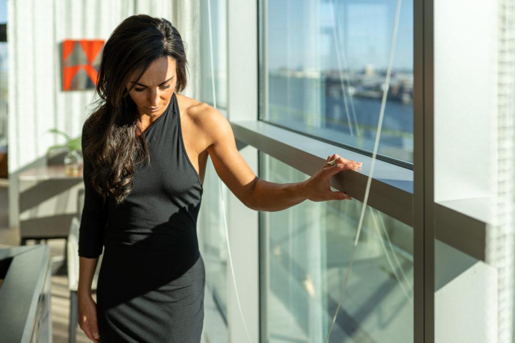Model wearing a black dress.