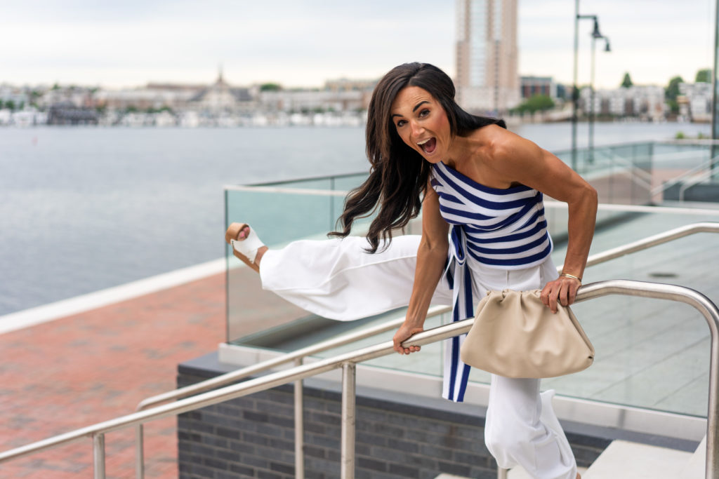 Model wearing blue and white striped top.