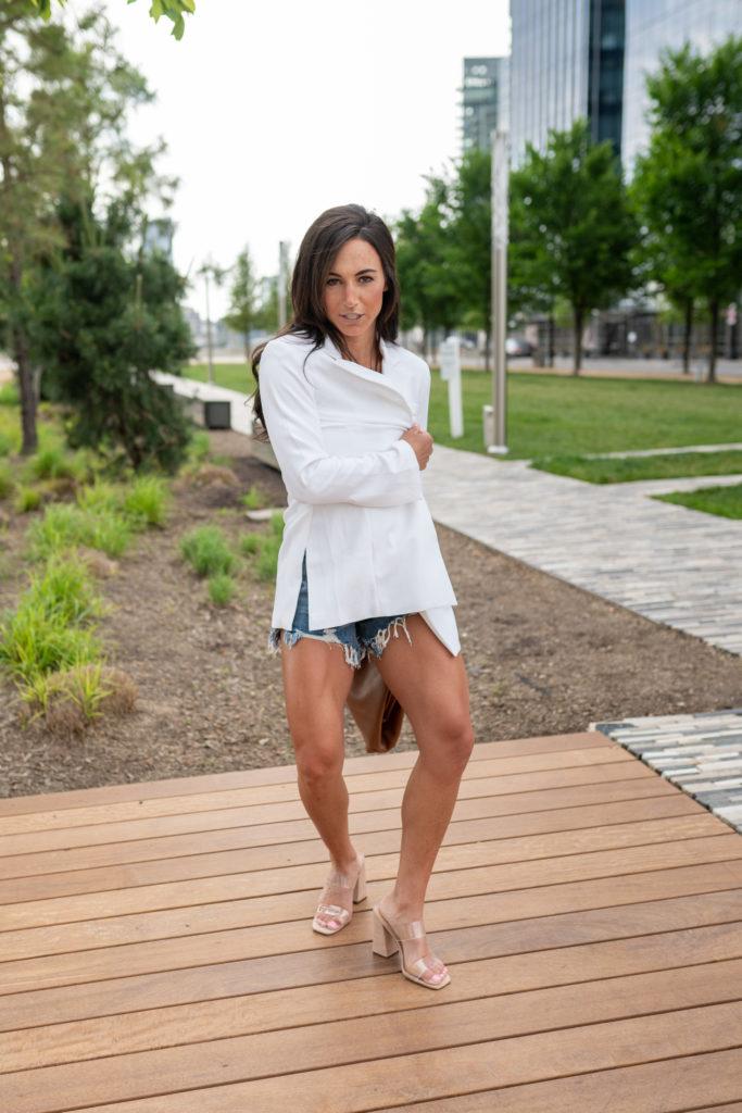 model wearing white blazer.